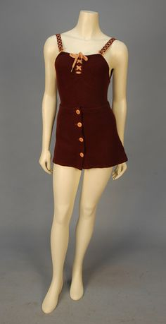 1930s LADY'S JANTZEN WOOL KNIT SWIMSUIT and SKIRT. Maroon maillot having pink diamond stitched straps with pink bakelite loop and barbell closures, pink knit lacing at front bodice top, hip with diver applique, inside cloth label. Matching short wrap skirt with four pink buttons. B-34, L-27, Skirt W-26, L-12.
