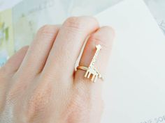 giraffe ring in Gold / Silver. $15.00, via Etsy.