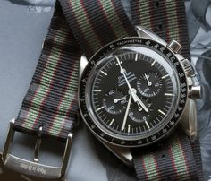 Omega Speedmaster Professional 'Moonwatch' on NATO. 42 mm. Ref. 3873.50.31 (with sapphire crystal). Retails for 5,400 USD. Note, this 'Bond Goldfinger-style' NATO is made by Corvus: http://www.corvuswatch.com/