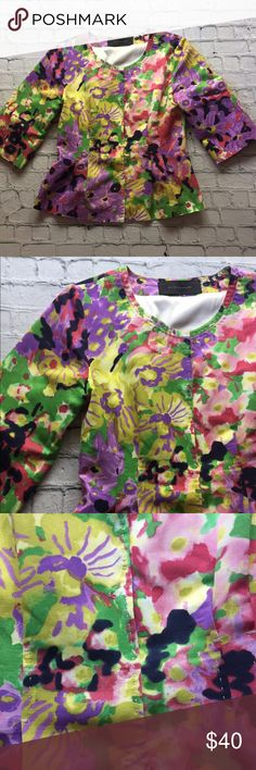 """Elie Tahari Floral Blazer Beautiful Elie Tahari blazer in vibrant spring colors. It has a six snap front closure and 3/4 length sleeves. The floral pattern is in purple, yellow, pink, green, and black. The stitching visible and provides a pretty look. There are pleats in the front and back. One snap appears to have come undone and was restitched. The size tag is missing. Measurements:  17"""" armpit to armpit and 23"""" in length. Elie Tahari Jackets & Coats Blazers"""