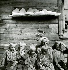 "Look at that shelf just loaded with ""Grandmother's Cheese,"" a type of farmer's cheese that my Grandmother made. So delicious! Its distinctive shape is formed by the cheesecloth holding the curd as it ""drip dries."" Antanas Sutkus. Lithuanian Family. Aukštaitija 1967"