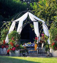 Hoop Arbor with Pergola Frame  Arbor, roses, patio, outdoor living, furniture, landscape, flowers, walkway, stone/brick, hedge, garden, path, pergola, trellis   Outdoor Spaces