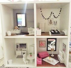 SCANDINAVIAN INSPIRED BOOKCASE DOLLHOUSE - Dollhouse made from a bookcase, spray painted plastic furniture and other craft materials. Used magazine images for art for the artwork, contact paper for the flooring and craft paper for the walls. My daughter loved it!