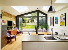Creating a large family home with an open-plan kitchen extension and loft conversion. Extension Veranda, House Extension Design, Glass Extension, House Design, Extension Ideas, Rear Extension, House Extension Plans, Extension Google, Side Return Extension