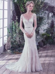 f0e3a3b4e9cc Maggie Sottero Roberta - This classic sheath wedding dress features  embellished illusion lace over jersey   atop a feminine sweetheart neckline  and long ...