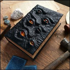 The Watcher by MilleCuirs Necronomicon spellbook spell book tome journal diary… Each one of these grimoire are one of a kind. Made using black bullfrog textured leather. Handmade glass eyes of various shapes and origins. The Watcher Propnomicon: Tomecra Halloween Spells, Halloween Books, Holidays Halloween, Halloween Crafts, Handmade Books, Journal Covers, Book Binding, Book Of Shadows, Book Making