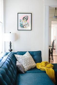 The print on the wall is a Kime Buzzelli drawing, an artist from Los Angeles. living room