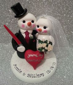 Snowman cake topper  http://www.tinylove-wedding-cake-toppers.co.uk/