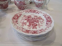 This listing is for a set of (7) dessert or bread and butter plates, that measure 6 in size. From England, they are red transfer ware in the beautiful Old English Bouquet pattern. Perfect condition.