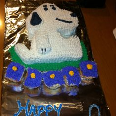 Snoopy cake I just made for a co worker.  Not to bad.  Lol