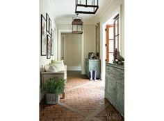 LOVE the floors.  Perfect for a foyer, kitchen, laundry and mud room!  reminds me of my Mema's old brick floors.