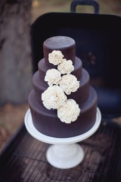 We're having our cake modeled after this one just so we can have balsa wood flowers on it!