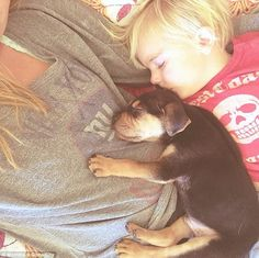 Pup and small child take naps together. By the time you see all five, you will be on cuteness overload.
