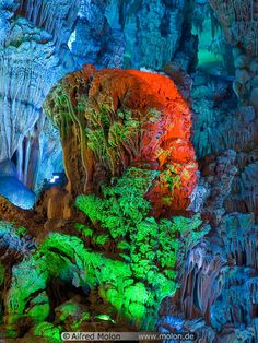 Reed Flute Cave   Guanxi or Guilin, China    The cave contains an overwhelming abundance of speleothems lighted in a typical Chinese manner with colored lights.    http://www.travelguilinguide.com/sight/guilin/8.html