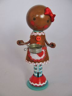 gingerbread girl clothespin doll. I like the bow. And the blue neck.