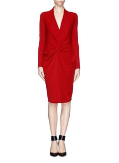 Lanvin updates occasion dressing with a literal twist in this knotted front knit dress. Decked in a luscious lipstick red, this piece will let you stand out from the fashion crew day and night.
