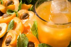 A summer cocktail recipe of muddled apricots and mint mixed with rye whiskey and lemon juice