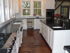 white cabinetry soapstone wide plank pine floors