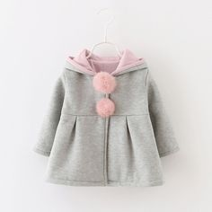 * Pom pom decor<br /> * Pleats details<br /> * Hood with rabbit ears<br /> * Material: 95% Cotton, 5% Polyester<br /> * Machine wash, tumble dry<br /> * Imported<br /> <br /> Featuring hoodie with adorable rabbit ears for a touch of extra sweetness, this super-stylish number will keep your little girl warm and cozy on windy days during those transitional seasons. The button down the front offers ample room and create...