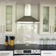 Cape 27 - kitchens - glass canisters, stainless steel appliances, Ikea kitchen cabinets, off-white kitchen cabinets, adel door cabinets, soapstone countertops, white subway tiles, white subway tile backsplash, ikea doors, ikea ramsjo doors,