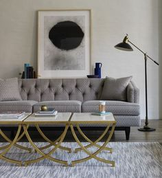Coffeetable love: The gorgeous Chester sofa and the fresh look of bunched Haviland tables with a luxe gold finish. Love the lyrical quality of the lines of the tables against the squareness of the sofa. The gold adds a pop of richness to the restrained palette.