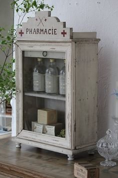 Add the top piece to a ready made cabinet and distress. Cute conversation piece.