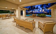Covered Pool-side Lounging and Indoor/Outdoor Dining and Living Areas
