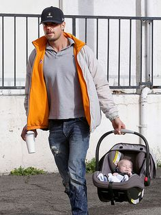 Josh Duhamel carries his slumbering sweetie, 3-month-old son Axl, to the car after breakfast in Brentwood, California on December 23, 2013.