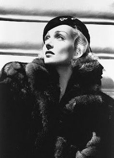 Carole Lombard wearing Travis Banton. 1930s. Hollywood, its stars andtheir costume designers like Banton, Adrian, etc., had major influence on 1930s fashion.