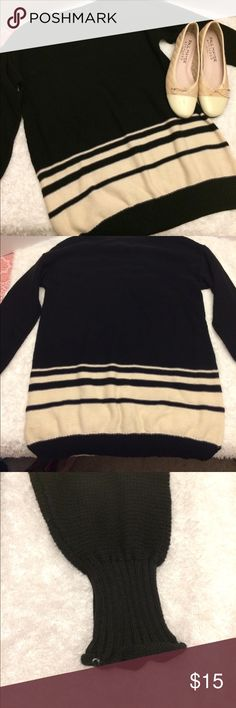 Oversized Sweater by daisy fuentes size medium Black and cream colored oversized sweater by Daisy Fuentes.  This would go fantastic with a pair of leggings and cream colored flats! Size medium. Worn one time. Daisy Fuentes Sweaters