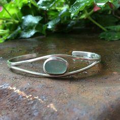 Sea glass jewelry,  Bezel set blue sea glass bangle bracelet by FatCatsOnTheBeach on Etsy