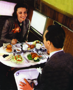 A quiet tete a tete over dinner in the late 1930s, the golden age of air travel.