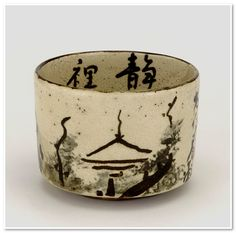 Tea bowl with design of mountain retreat mid 18th century  Ogata Ihachi (Kyoto Kenzan II) active 1720-1760) Edo period  Buff clay; white slip, iron and cobalt pigments under transparent glaze; gold lacquer repairs H: 7.3 W: 10.0 cm