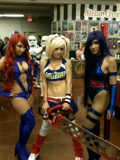3girls armband belly button piercing belt blonde hair blood bodysuit boots breasts chainsaw cleavage cleavage cutout cosplay croptop dc comics detached sleeves elbow gloves fingerless gloves gloves halter top hand on hip high heels jessica nigri juliet s