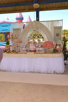 I like the idea of tulle skirting the main table and the gold overlay. I also like the gold stands.