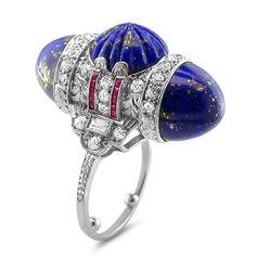 Art Deco lapis ruby diamond bullet ring, csrved lapis lazuli, calibre rubies and diamonds.