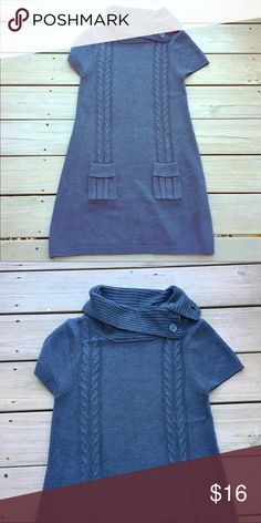Gray short sleeve tunic length sweater XL fits like Large/smaller XL. Dark gray sweater with pretty detail on the front. So perfect w boots and skinny jeans. Sweaters