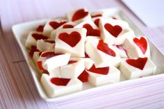 """Jello Hearts by Hungry Housewife - make jiggler recipe with the red, then cut out hearts and put in 9 x 12"""" pan then fill with sweetened condensed milk mixed with plain gelatin. #valentines"""