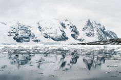 Mountains With Reflections in Pleaneu Bay, Antarctica