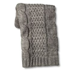 """• 100% acrylic construction<br>• Cable knit design<br>• Midweight<br>• 60x50""""<br>• Machine washable for easy care<br><br>The Threshold Cable Knit Throw in Gray is a lovely blend of style and comfort. When you're not wrapped up in it, toss this throw over your sofa or a favorite chair to show off the beautiful knit pattern."""