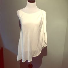 BCBG Generation top Beautiful flowing top in white. Two layers of material, bottom layer is a tank top with overlay consisting of one shoulder of draped material. Fits 4-6. Small snag on right shoulder. See picture. BCBG Generation Tops