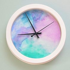 Learn how to make your own gorgeous watercolor clock using a few paints and an inexpensive clock from Target!