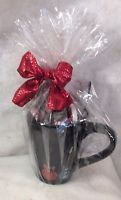 Nashville black guitar wrapped mug.  Filled with Nashville keepsakes and wrapped in cello and tied with a red bow. Terrific gift for meeting mementos thank you gifts, bachelor parties favors.