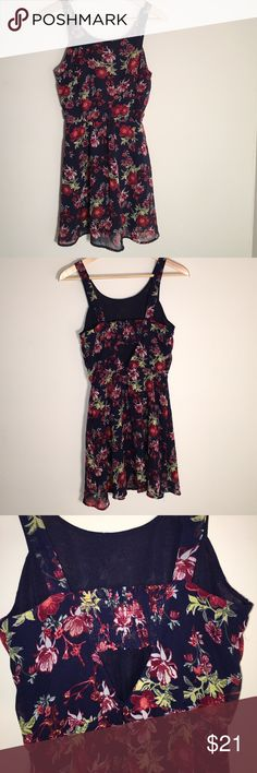 """Divided Sundress, Size 4 Fully lined sundress has elastic insert and open V cutout at back, elastic waist. Underarm to underarm 15"""" flat.  Length shoulder to hem - 32"""". Polyester fabric. Base color is navy blue with floral design. Size 4. New without tags. Divided Dresses"""