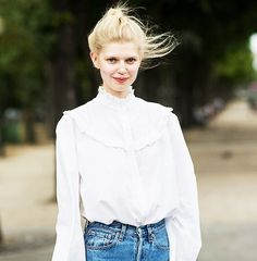 A Victorian blouse is paired with high-waisted jeans