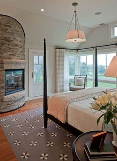 Farmhouse Meets Modern. Same home tour. Master bedroom suite, with a space to sit for TV, and a lovely fireplace near the bed. So pretty.