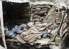 WWI, July 1917; Two soldiers sleep in La Harazee, in the north of France, close to the French border with Luxembourg. The shots were brought to life by graphic artist Frederic Duriez who has added colour to the stark images of the French troops