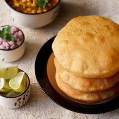 Bhaturas are thick leavened fried Indian bread often eaten with chole (spicy curried garbanzo beans or chick peas)