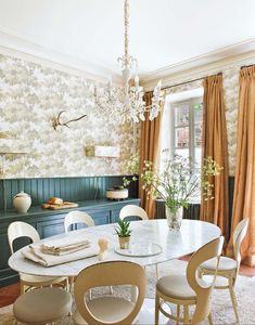 blue-green wainscotting subtle wallpaper Saarinen marble topped oval dining table (forever on my lust have list) and chandelier long, floor-sweeping curtains- very elegant and quite beautiful room just to be in