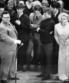John Lennon, Richard Starkey, and Paul McCartney with Harry Secombe (left), Marlene Dietrich (far right) and Tommy Steele (second right)